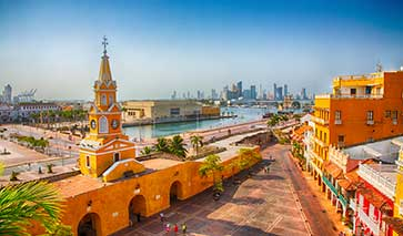 Coastal city in Colombia with orange buildings in the foreground