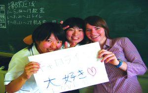 Girls holding TEFL certificate