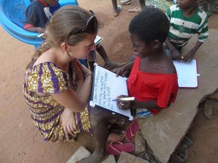 Kelsey with student in Ghana