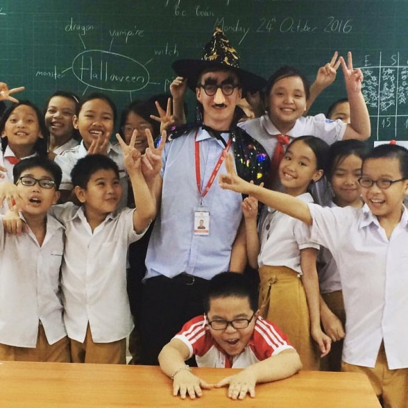 TEFL teacher in fancy dress with his class