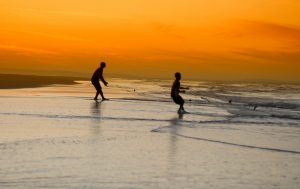 two people fishing in the sea