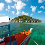 A boat sailing to a Thai island