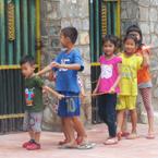 Children play in the street in Phnom Penh, Cambodia