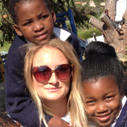 South Africa TEFL intern Megan with two of her students at school in Cape Town