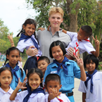Thailand TEFL intern Harrison White with his students at school in Ayutthaya, Thailand