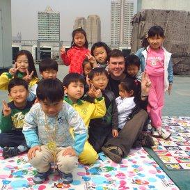 http://TEFLteacherwithpupilsinSouthKorea-outdoorclassroomactivity