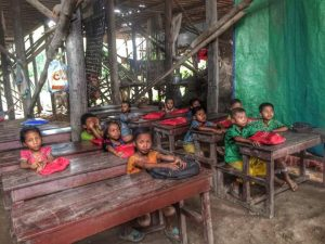 Students at a makeshift school at a floating village near Siem Reap, Cambodia