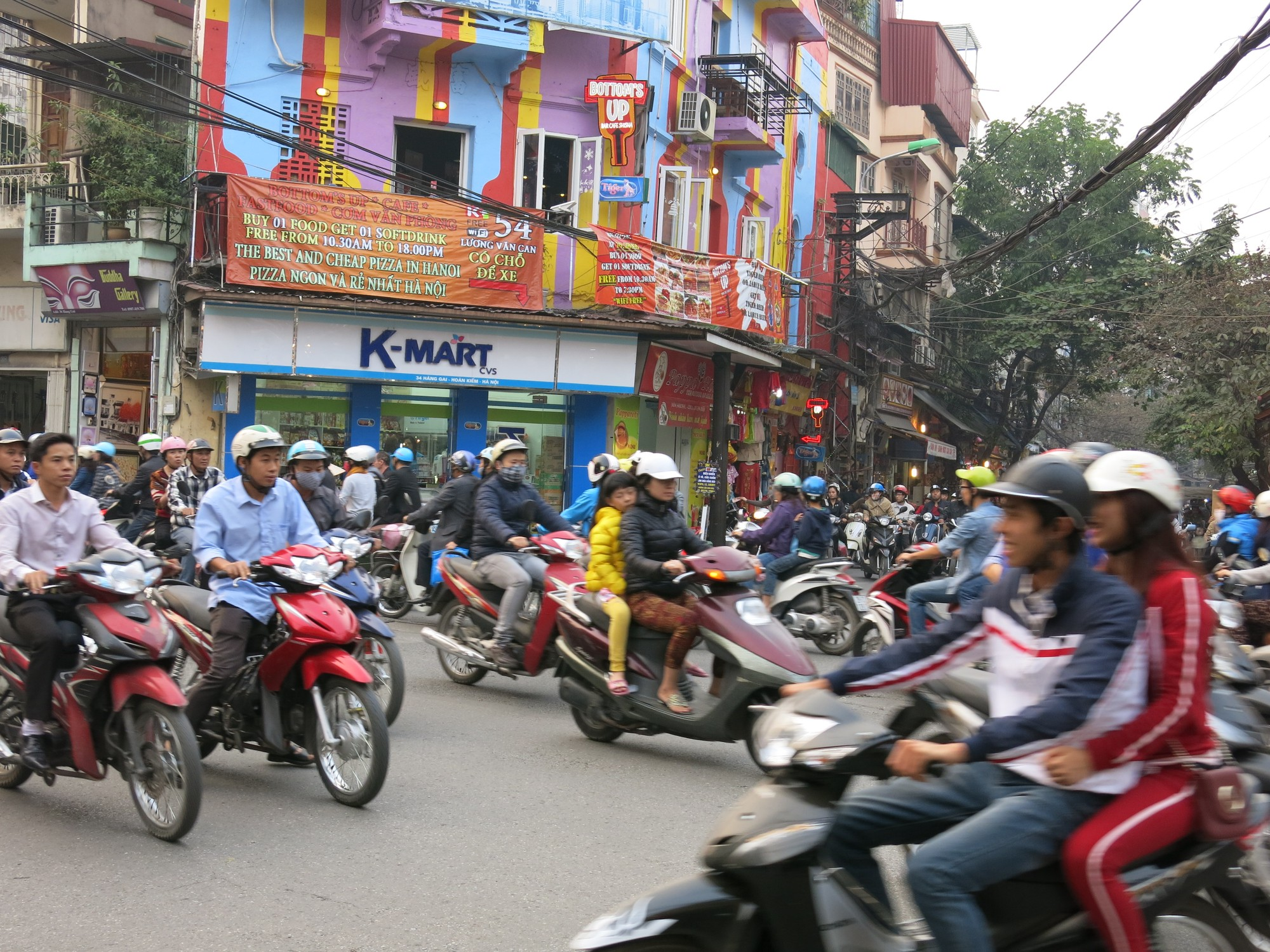 Crowds of motorbikes and mopeds on the street in Hanoi, Vietnam