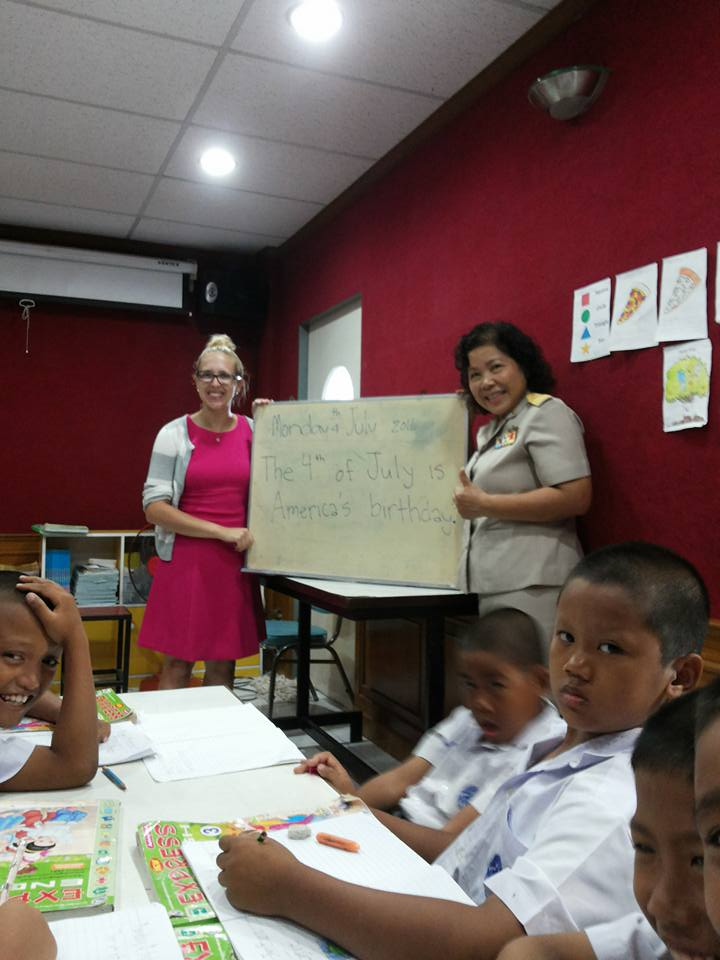 i-to-i intern Jessi in class with a fellow teacher and her students at school in Kanchanaburi, Thailand