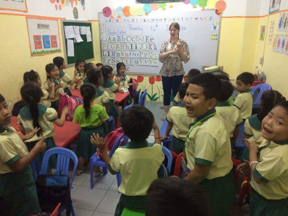 i-to-i Cambodia intern Ellen teaching her class of English students at school in Phnom Penh, Cambodia