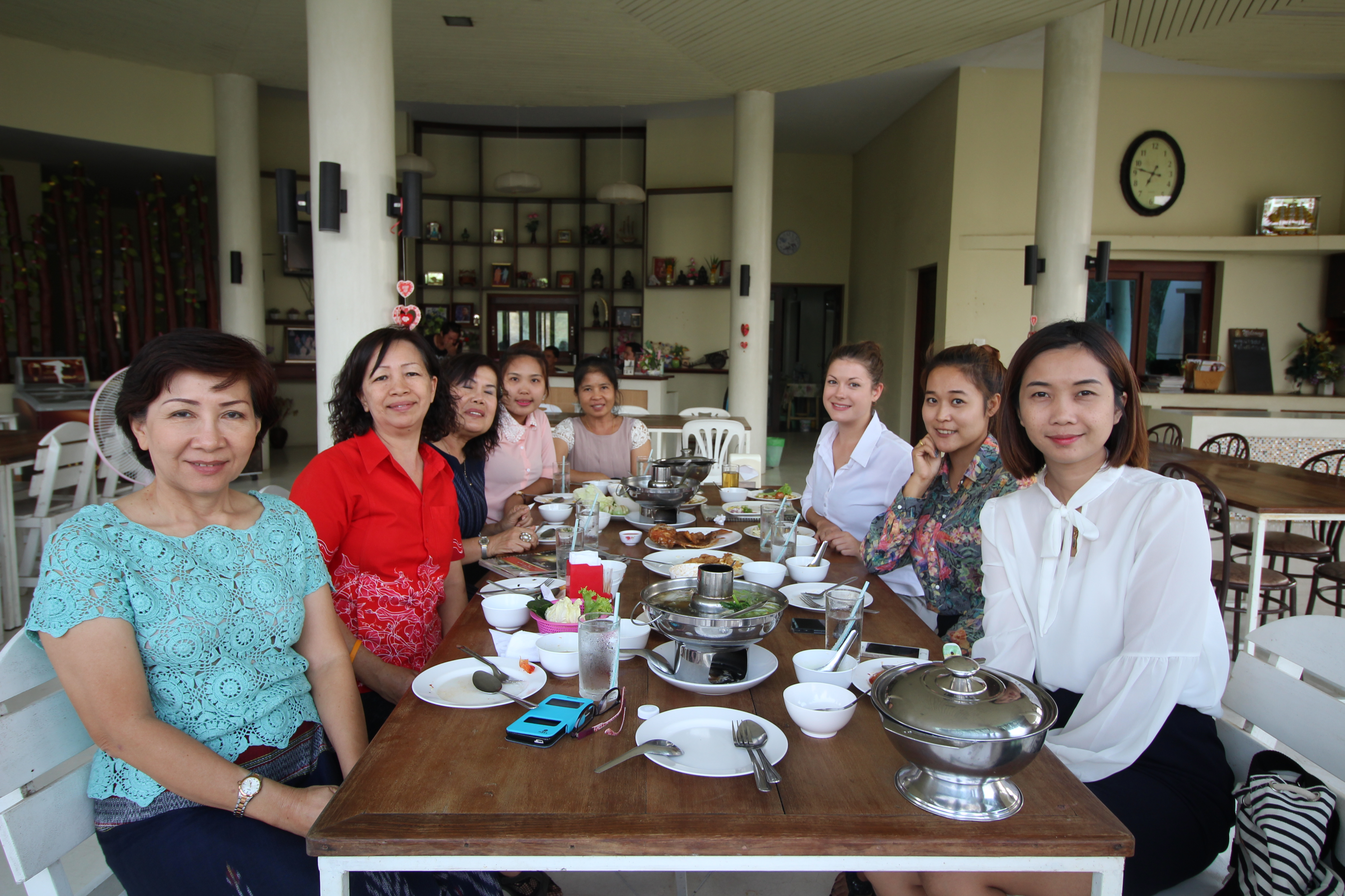 i-to-i interns with their fellow teachers enjoy a meal together in Kanchanaburi, Thailand