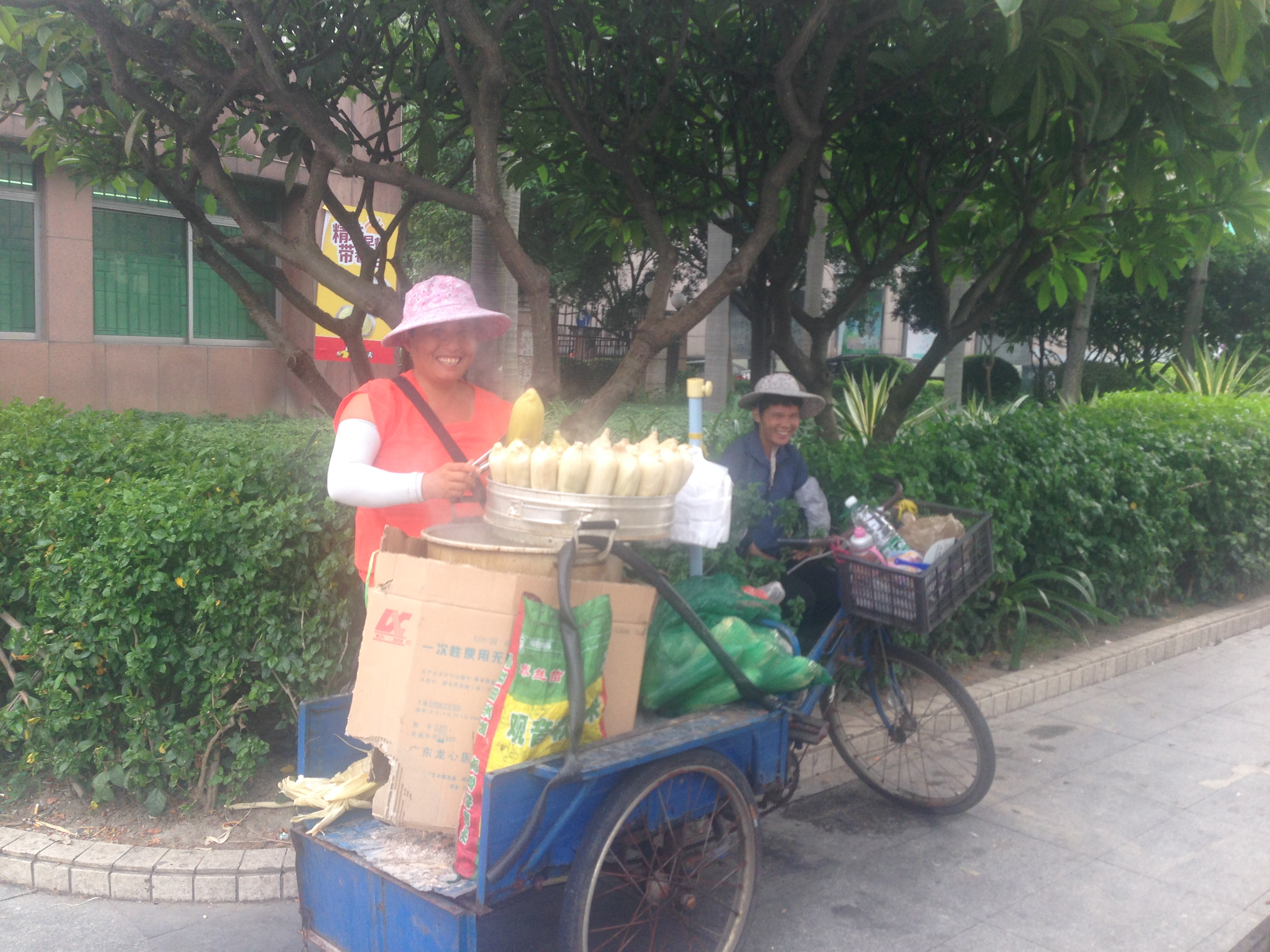 A fruit seller at a stall in Foshan, China