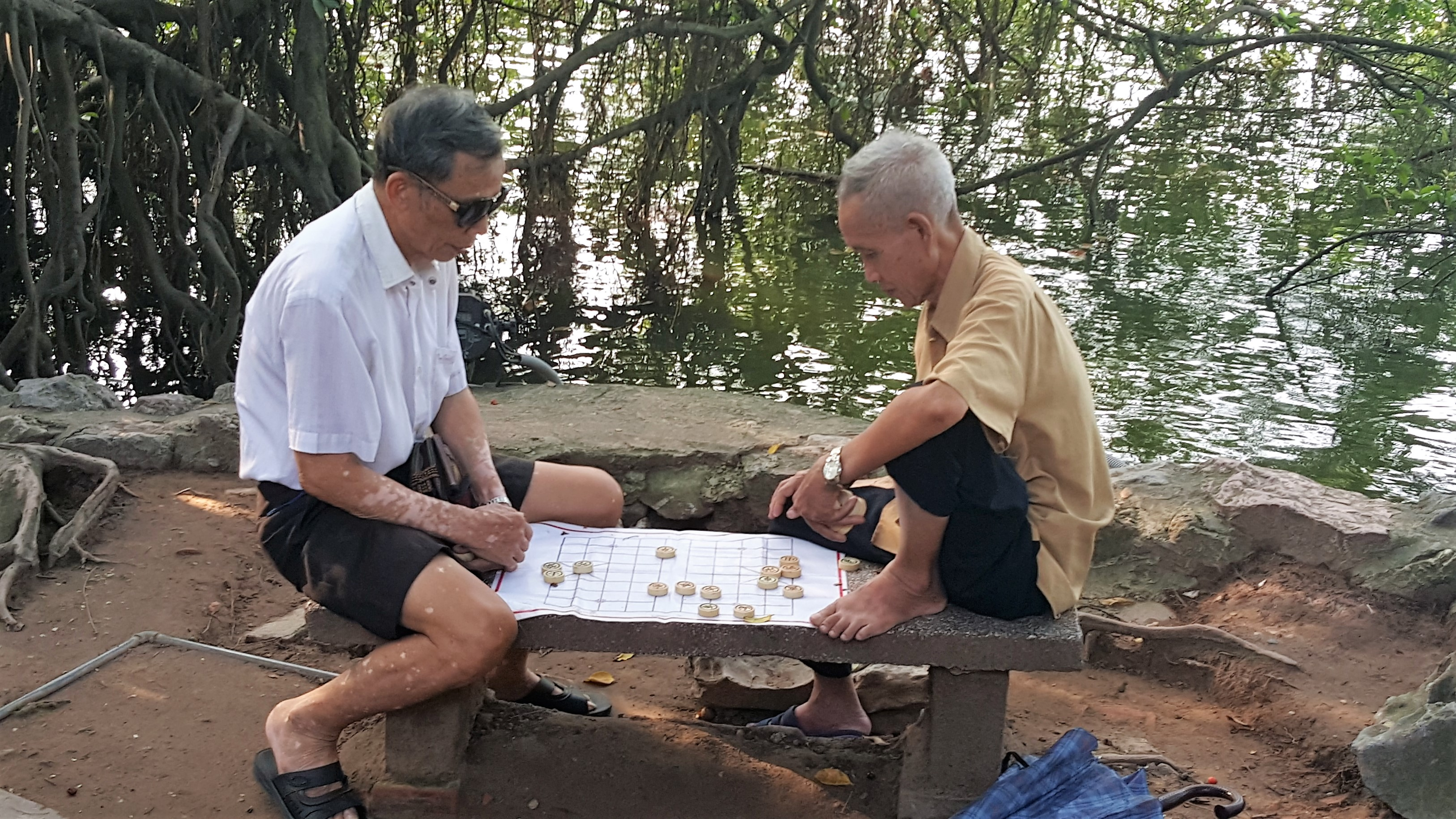 Men playing checkers in Hanoi, Vietnam