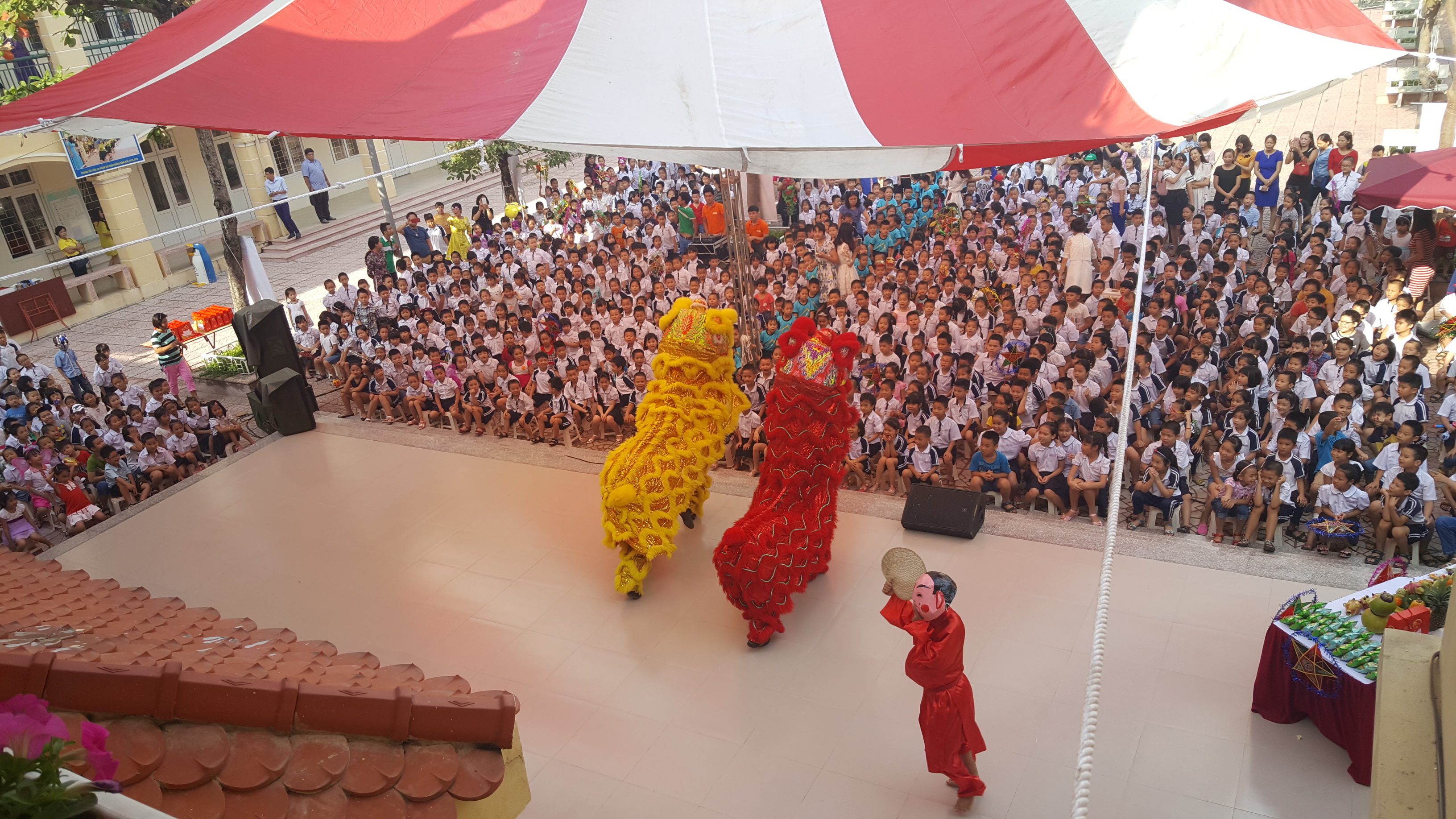 Performers do an assembly at school in Hanoi, Vietnam