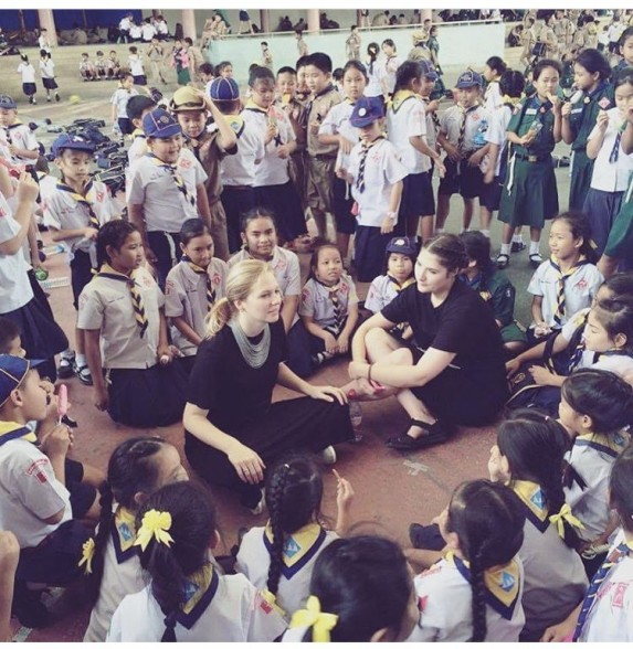 Teacher Becca with smiling pupils in Thailand