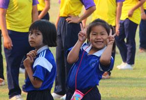 Schoolchildren posing for camera
