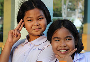 Schoolchildren at end of school day smiling for camera