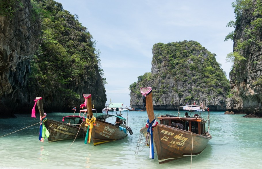 Phi Phi island in Thailand with colourful boats