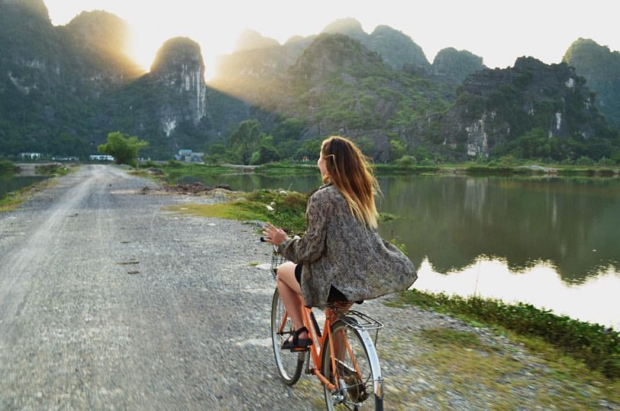 Woman riding a bike in Vietnam