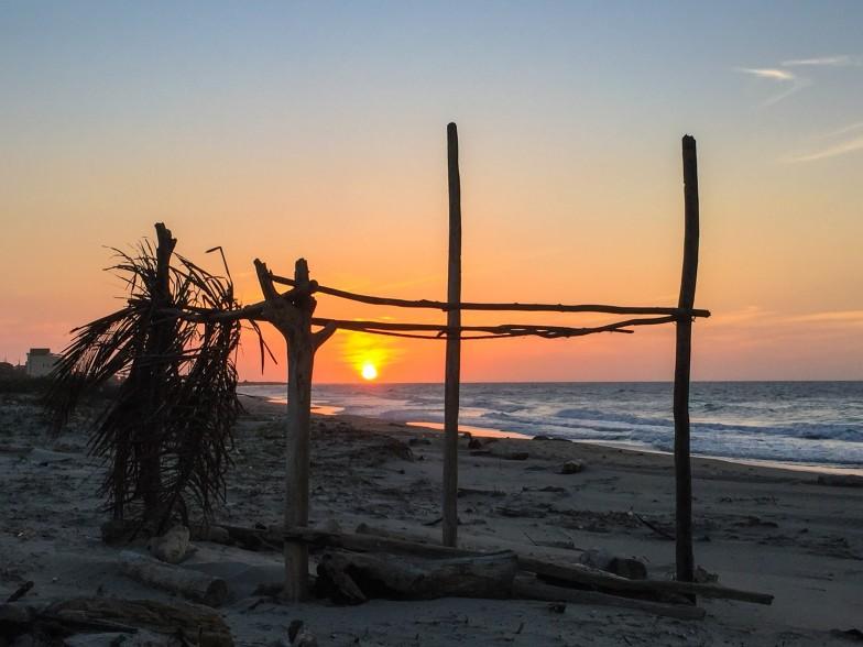 Sun setting on the horizon in Santa Veronica