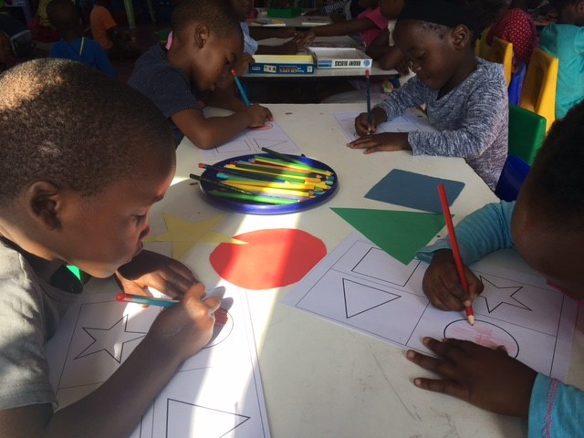 South African students colouring in shapes