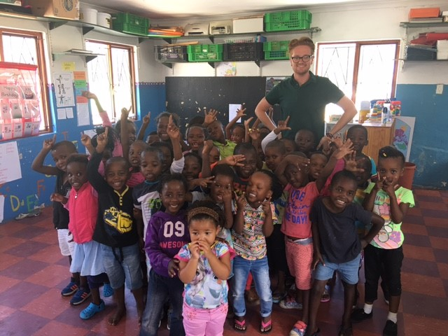 TEFL intern with his class of students in South Africa