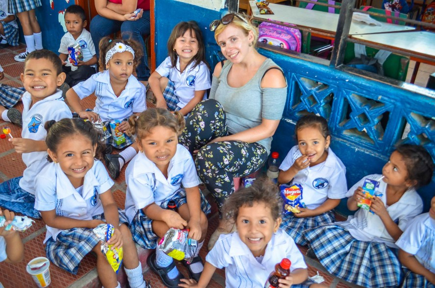TEFL teacher surrounded by students in Colombia
