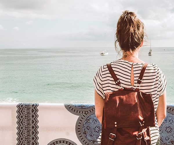 A girl travelling looking out to sea