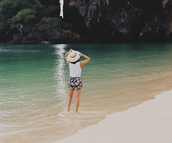 Girl in the sea on a beach in Thailand
