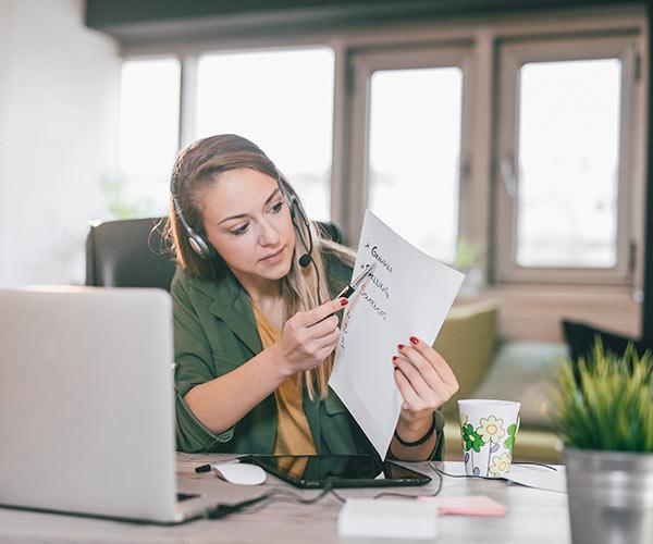 Woman on laptop teaching TEFL lesson