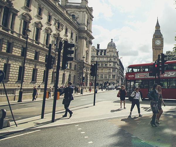 Man walking infront of Big Ben in London