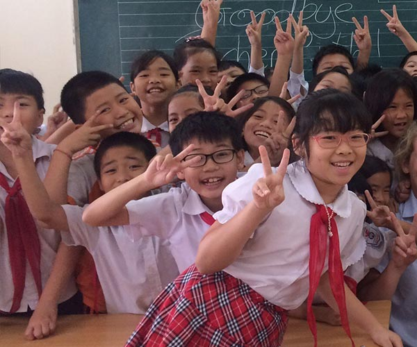 asian school children posing in classroom