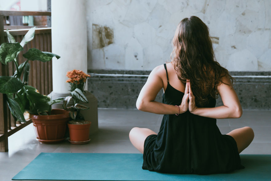 girl doing yoga on terrace