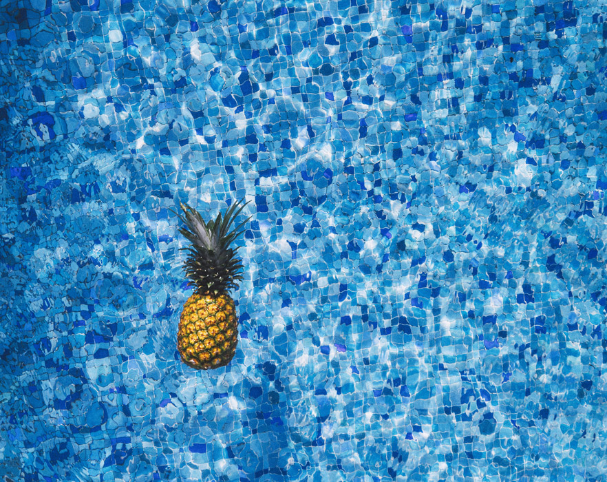 Pineapple in swimming pool