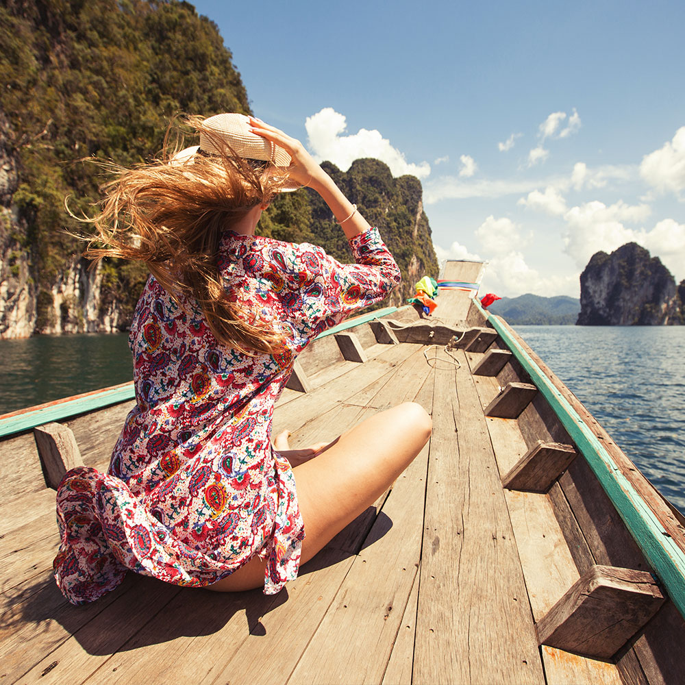 girl on boat in thailand