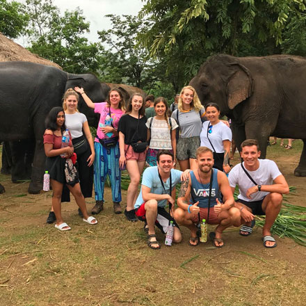 Alex with interns and elephant