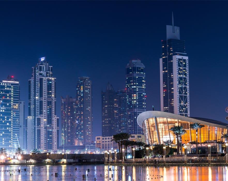 buildings by water in Dubai