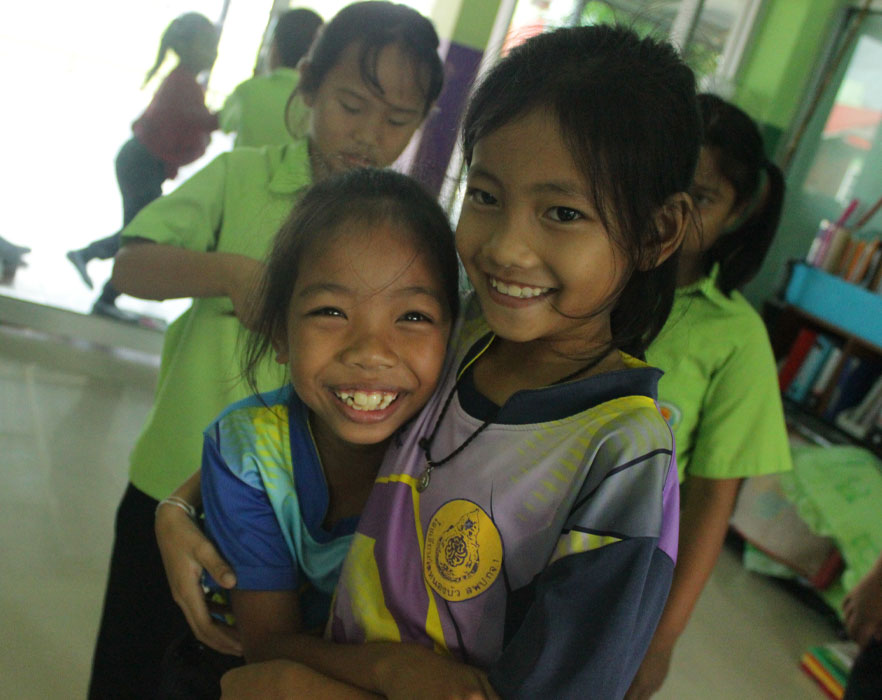 Two little girls smiling