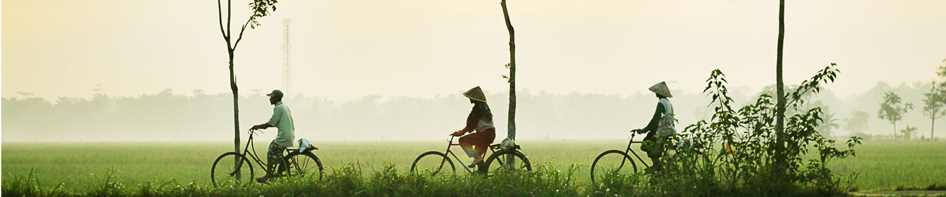 WOman riding a bike in Indonesia