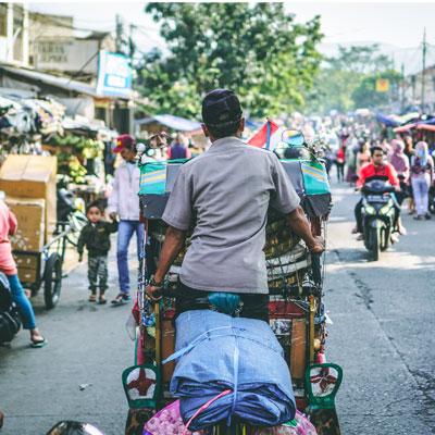 Indonesian street, man on TukTuk
