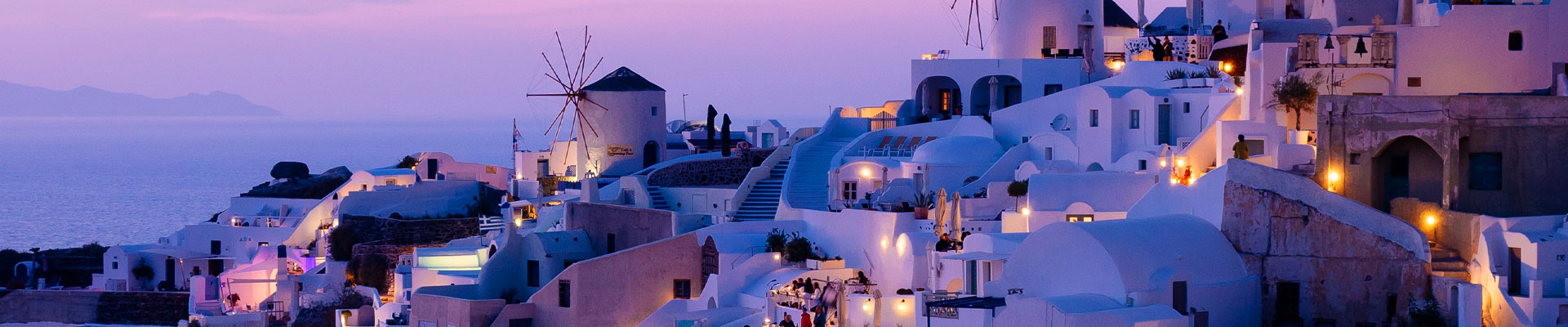White buildings with a purple glow in Greece