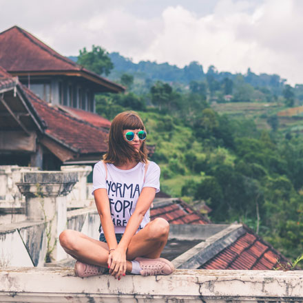 Female traveller on wall