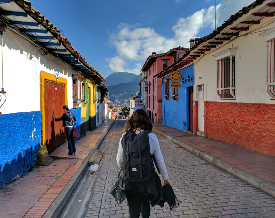Backpacker walking along Colombian street