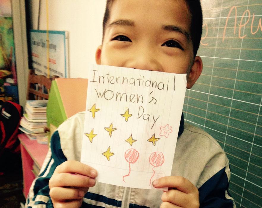 Student holding letter