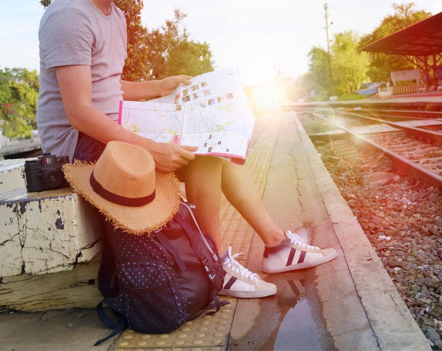 TEFL backpacker reading a map