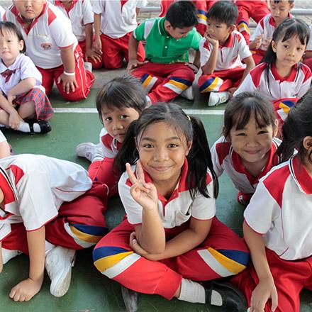 Children smiling in classroom