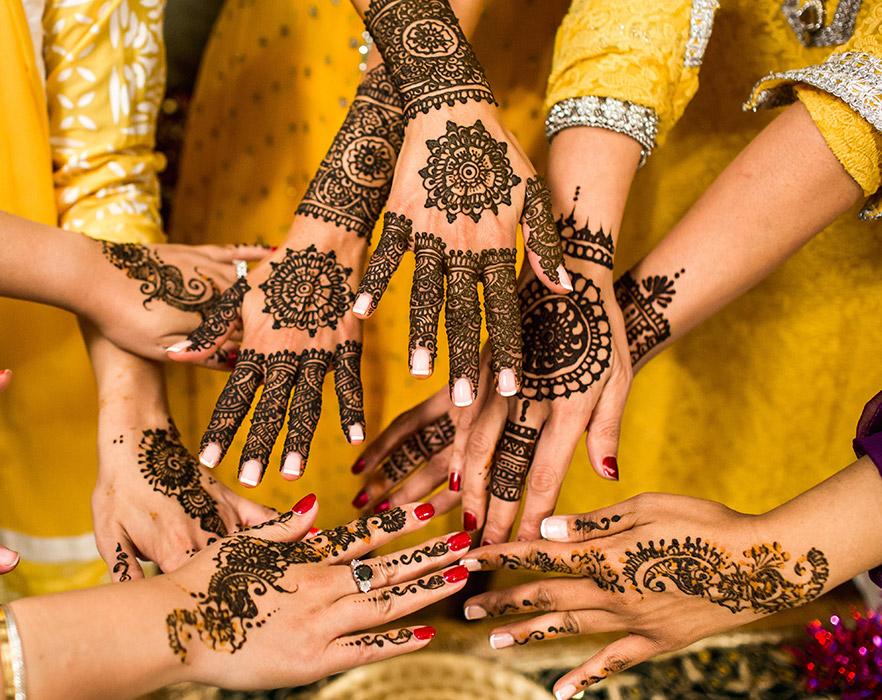 Henna tattoo'd hands