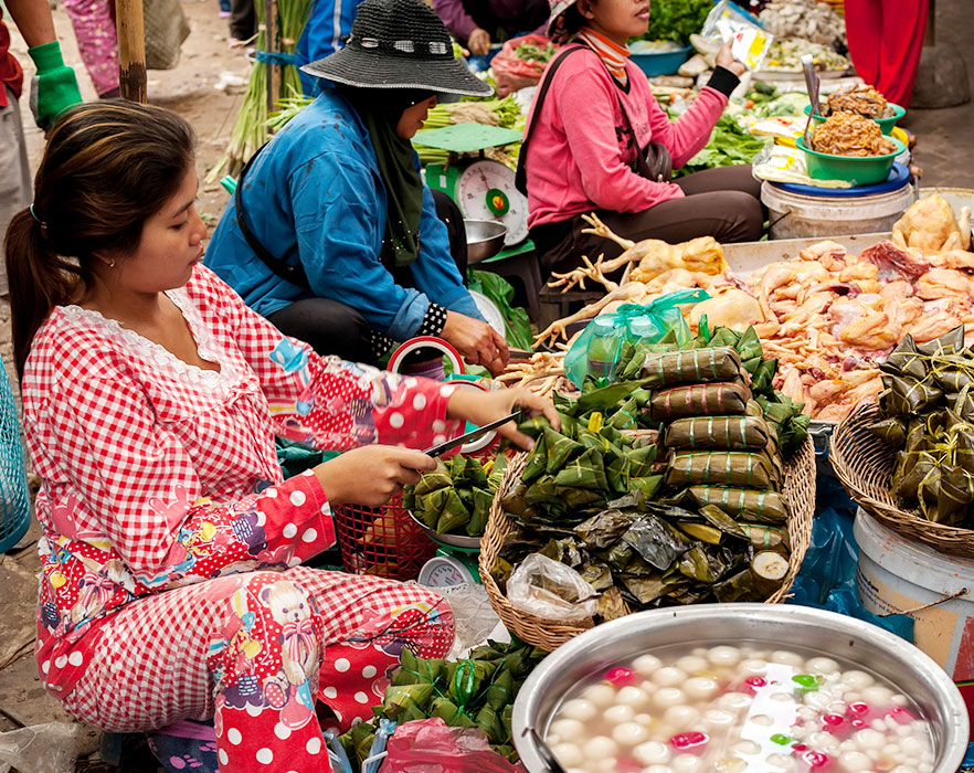 Khmer woman selling street food - Cambodia