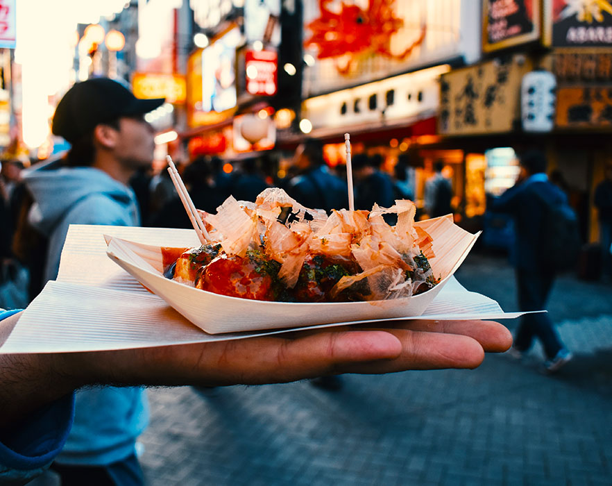 Man holding Japanese food