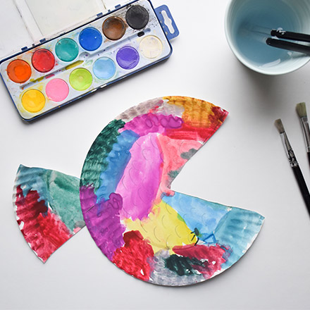 Painted fish made of recycled paper plate